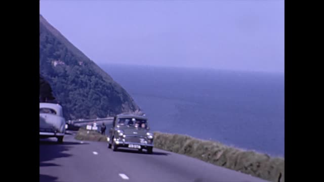 Car Driving POV down the steep hill into Lynmouth Devon UK 1965