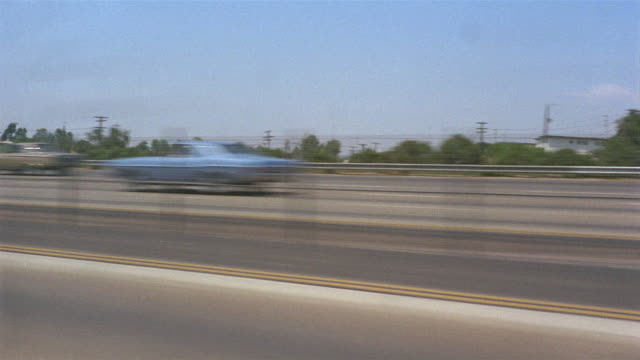 1955 POV Car driving fast on highway / Los Angeles, United States
