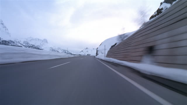pov, car driving fast on maloja pass, switzerland  - on the move video stock e b–roll