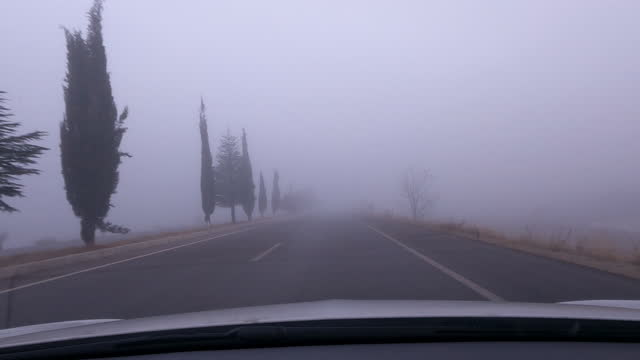 pov car driving in a misty road - traffic stock videos & royalty-free footage