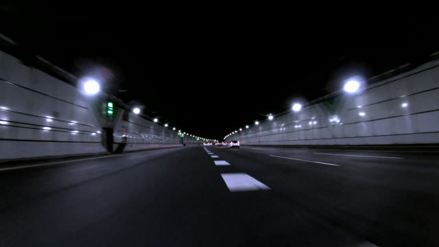 car driving in highway tunnel - vanishing point stock videos & royalty-free footage