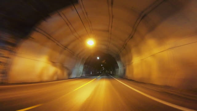 POV car driving in Norway: inside the tunnel