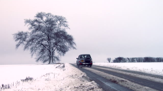 WS Car driving in rural setting during winter, Hertfordshire, UK