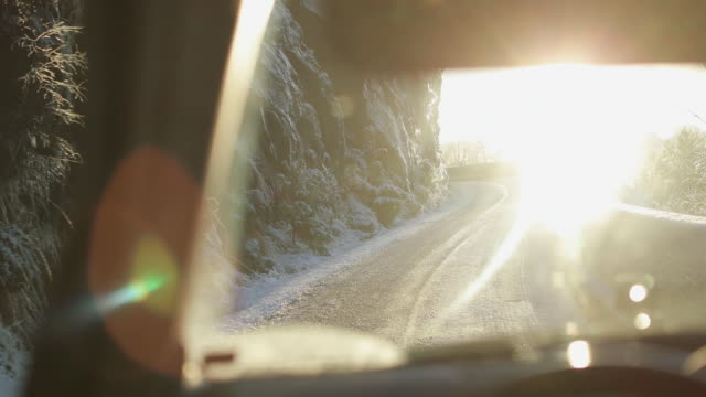 pov car driving in snow: mountain pass in norway - car point of view stock videos and b-roll footage