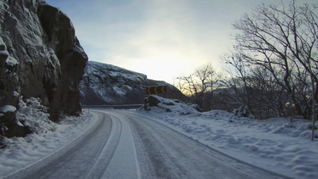 pov car driving in snow: mountain pass in norway - horizontal stock videos & royalty-free footage