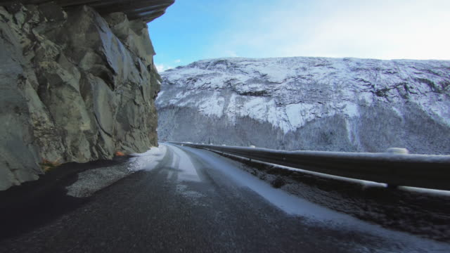 POV car driving in snow: mountain pass in Norway