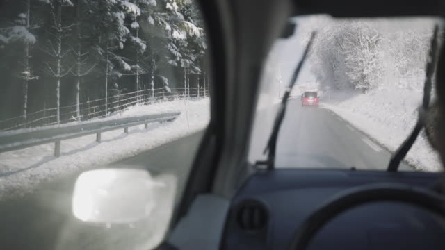 pov car driving in snow: mountain pass in winter - slippery stock videos and b-roll footage