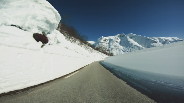 pov car driving in snow: mountain pass - blizzard stock videos & royalty-free footage