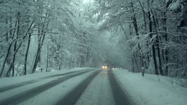car driving in snow - slow motion - peter snow stock videos & royalty-free footage