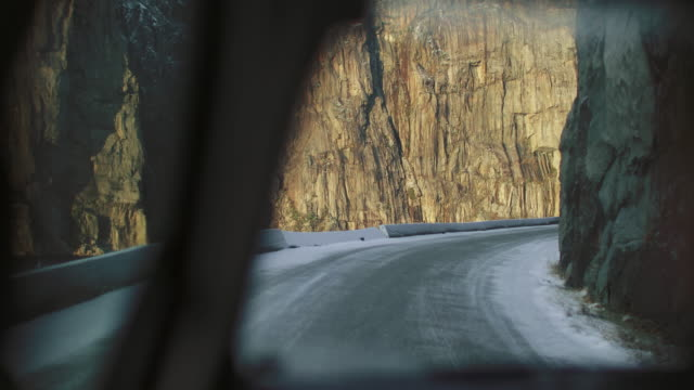 pov car driving in snow: the mountains of norway - slippery stock videos and b-roll footage
