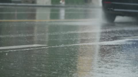 car driving in street at rainy day - slippery stock videos & royalty-free footage
