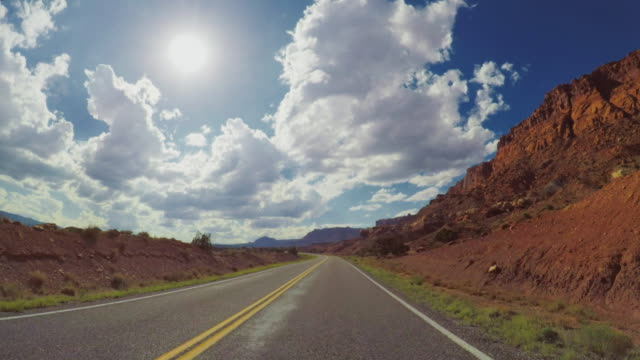 pov car driving in the canyon of usa - red rocks stock videos and b-roll footage