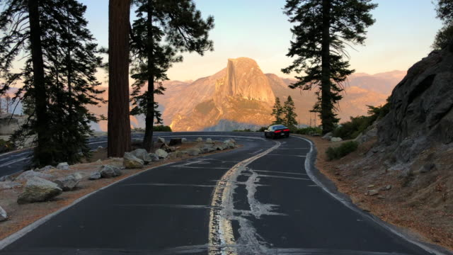 car driving in the glacier point with the stunning view of the half dome. - half dome stock videos & royalty-free footage