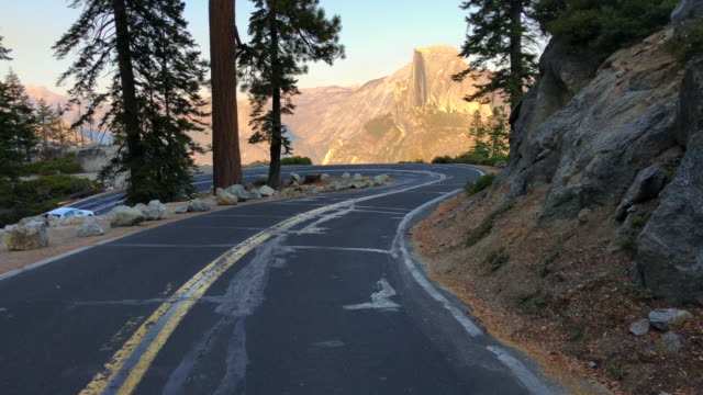 car driving in the glacier point with the stunning view of the half dome. - mariposa county stock videos and b-roll footage
