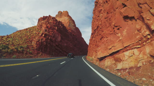 pov car driving in the highways of usa - red rocks stock videos & royalty-free footage