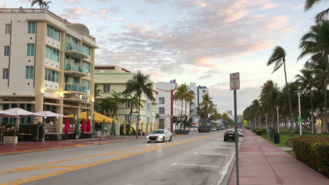 car driving in the miami beach street in the morning - miami beach stock videos & royalty-free footage
