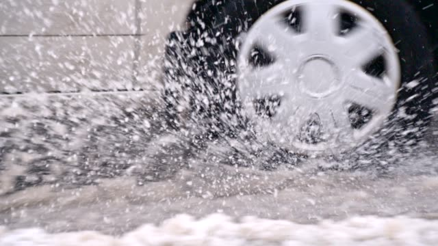 slo mo car driving in the snow - tyre stock videos & royalty-free footage
