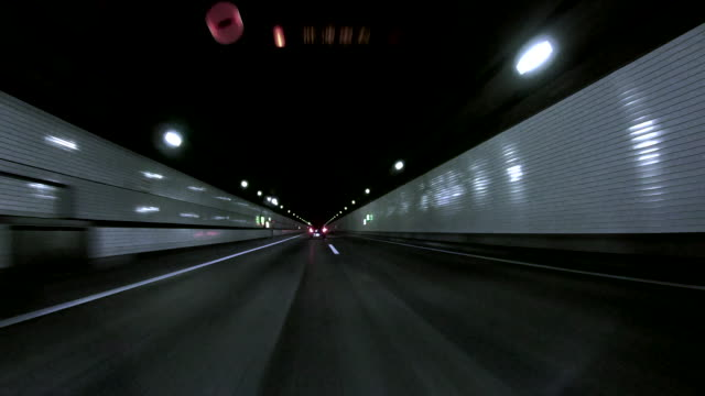 car driving in to tunnel ,tokyo aqua-line (trans tokyo bay highway) - concorrente video stock e b–roll