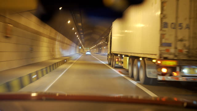 car driving in tunnel - trucking stock videos & royalty-free footage
