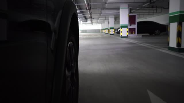 car driving in underground garage - 立体駐車場点の映像素材/bロール