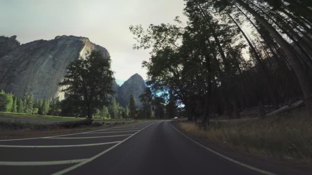 pov car driving in yosemite national park - californian sierra nevada stock videos & royalty-free footage