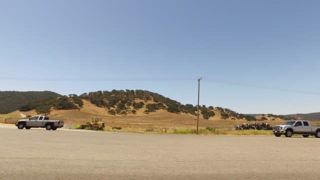 pov car driving, landscape along a highway in california - seitenansicht stock-videos und b-roll-filmmaterial