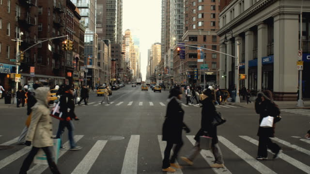 car pov driving north on sixth avenue in chelsea, stopping at 23rd street intersection / pedestrians passing / new york city - bewegliches hintergrundbild stock-videos und b-roll-filmmaterial