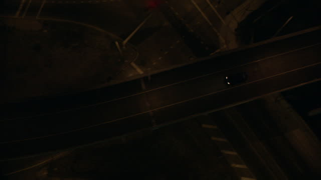 aerial a car driving on a bridge at night / new orleans, louisiana, united states - interstate 10 stock videos & royalty-free footage