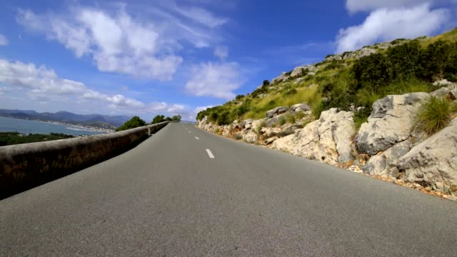 car pov: driving on a country road in majorca, spain - spain stock videos & royalty-free footage