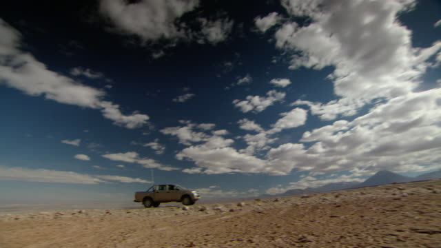 WS Car driving on a lonely desert road