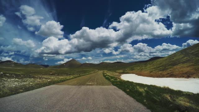 POV car driving on a mountain pass