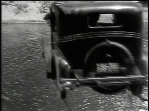 B/W 1932 REAR VIEW car driving on cables suspended over river with passengers / Barlow, OR