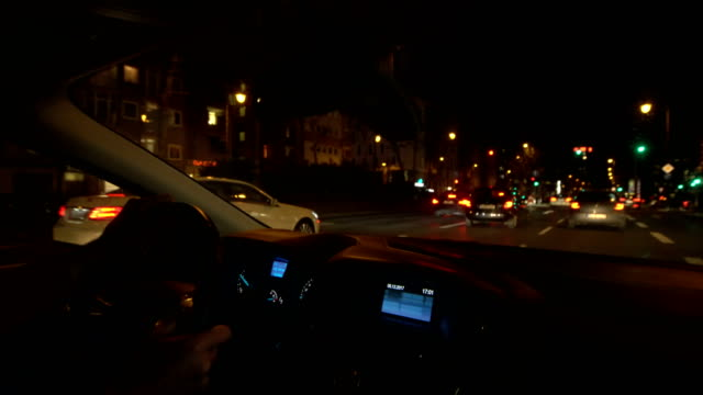 POV Car driving on city street at night