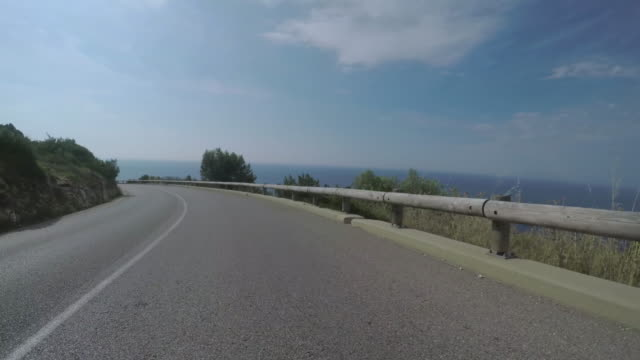 ws pov car driving on coastal hillside roads near the coast / france - monaco stock-videos und b-roll-filmmaterial