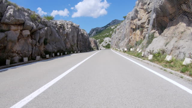 car driving on coastal road point of view - winding road stock videos & royalty-free footage