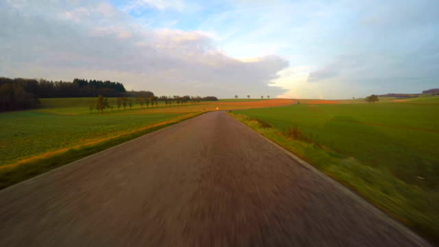 car driving on country road - empty road stock videos and b-roll footage