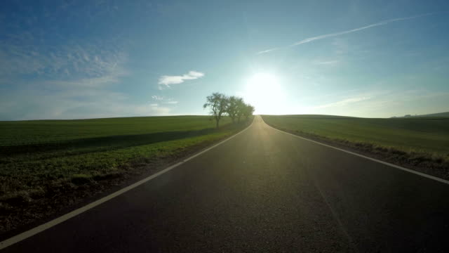 pov, car driving on country road - gerade stock-videos und b-roll-filmmaterial