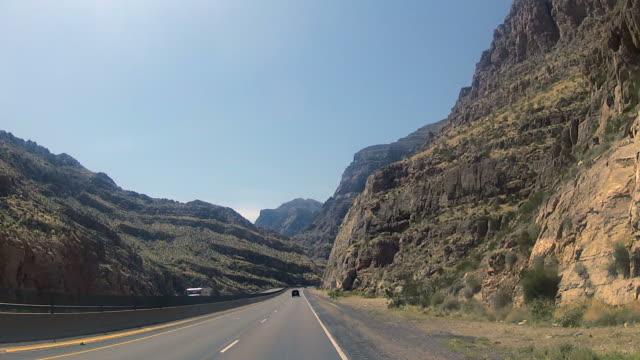 POV Car driving on desert highway