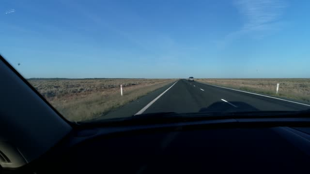 car pov driving on desert highway - country road stock videos & royalty-free footage