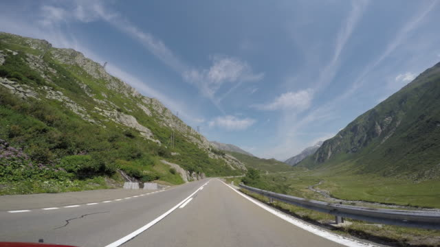 Car driving on high mountain pass POV
