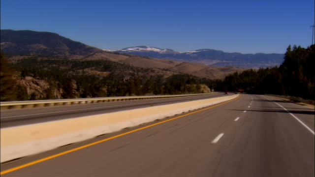 car pov driving on highway 10a with view of mountains in background / philipsburg, montana - 2006 stock videos & royalty-free footage