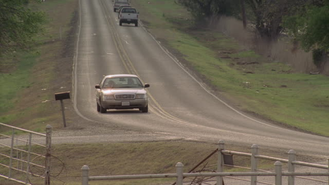ts car driving on highway and turning onto dirt road / united states - landfahrzeug stock-videos und b-roll-filmmaterial