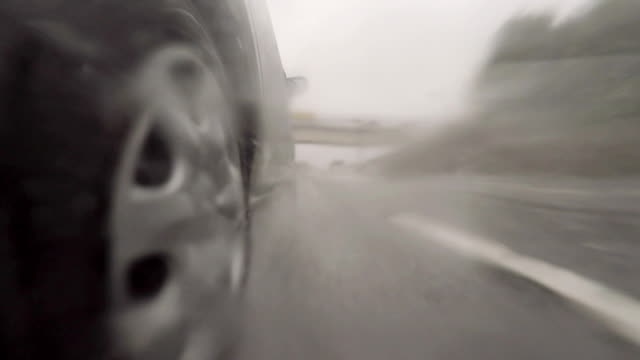 car driving on highway at rainy day - 4k - close to stock videos & royalty-free footage