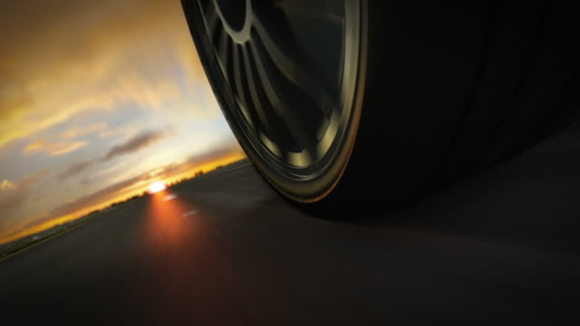 car driving on highway in suset. loopable cg. - tyre stock videos & royalty-free footage