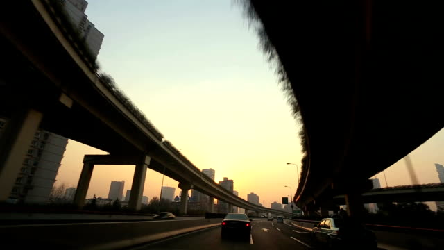 stockvideo's en b-roll-footage met car driving on highway,shanghai,china - tweebaansweg