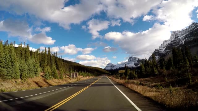 car driving on icefields parkway scenic road - canada stock videos & royalty-free footage