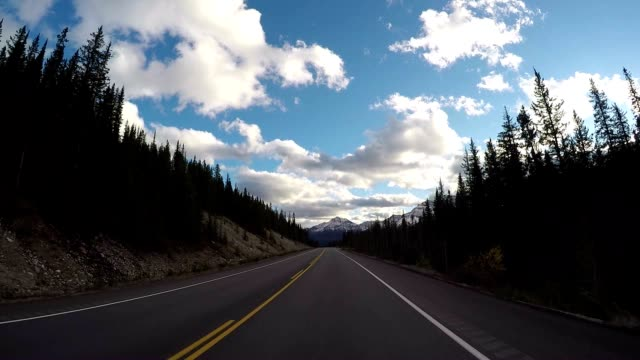 Car driving on Icefields parkway scenic road