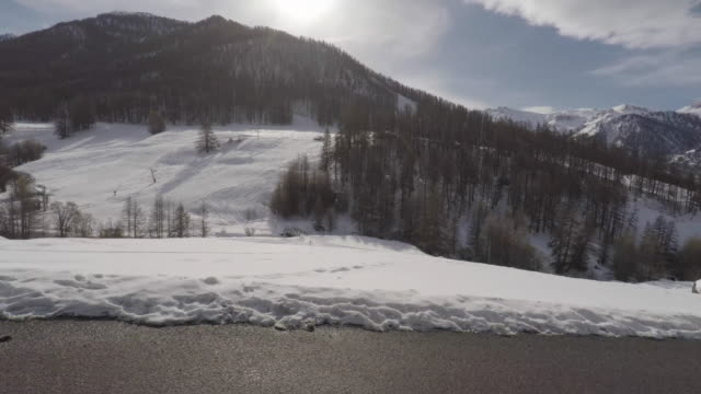 POV, Car driving on montain road with snow