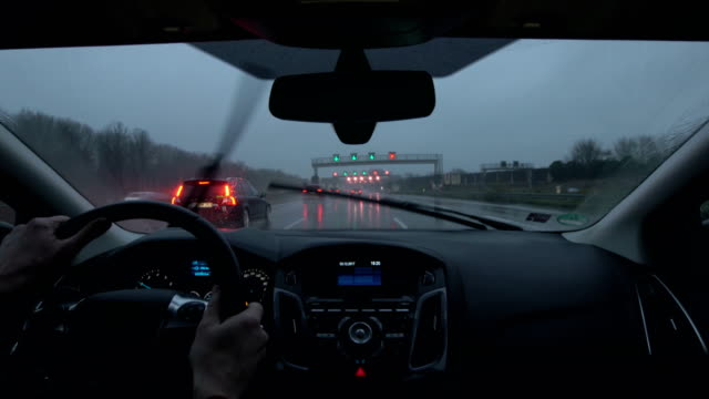 POV Car driving on motorway during rain