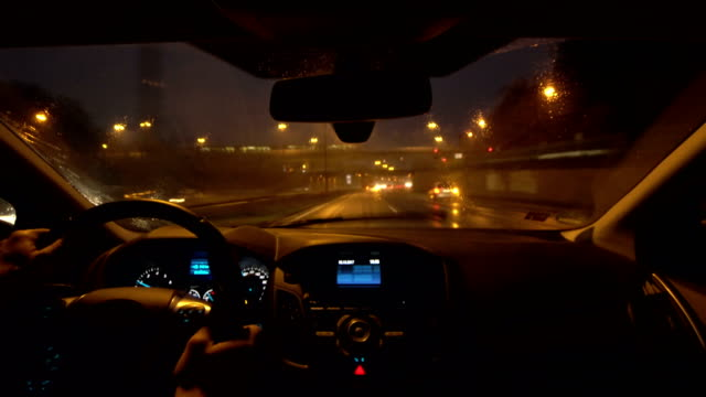 pov car driving on motorway during rain - dashboard stock videos & royalty-free footage